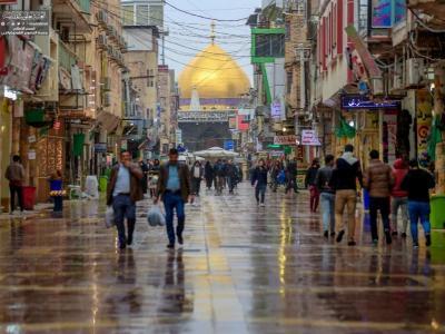 بارش باران رحمت الهی جلوه ویژه ای به حرم امیرالمؤمنین (ع) بخشید +تصاویر